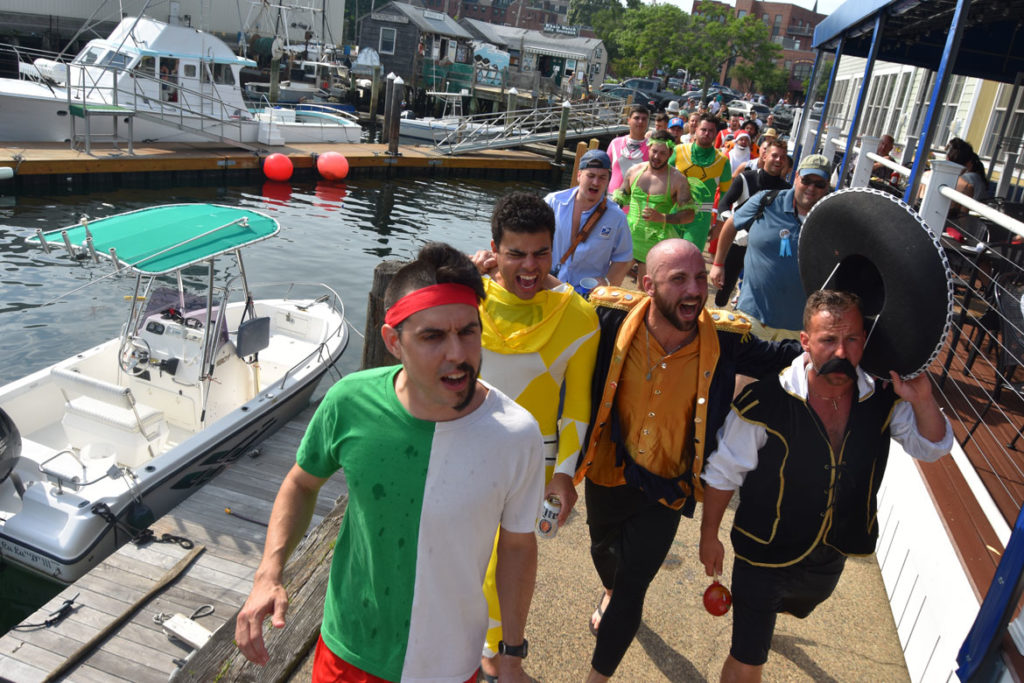 Greasy Pole walkers head to the Gloucester House tavern to celebrate and shout blessings in advance of the contest, June 30, 2018. (Greg Cook)
