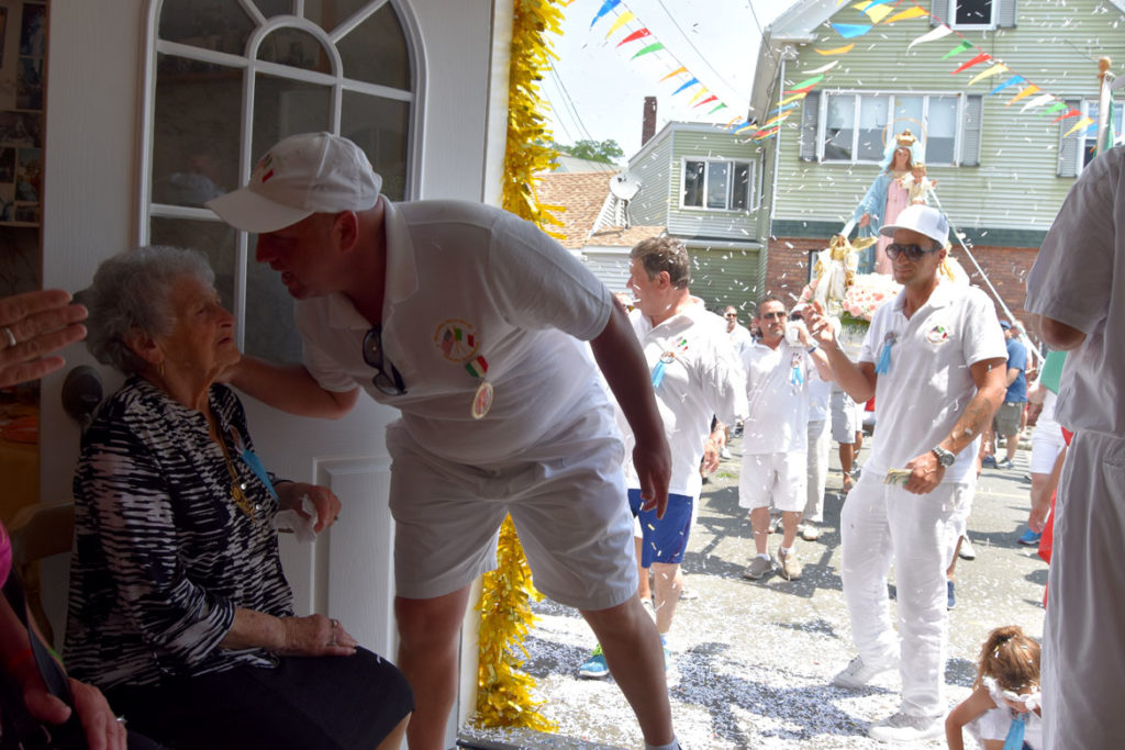 Gus MacIntosh visits his aunt at the Mother of Grace Club during Sunday's procession, July 1, 2018. (Greg Cook)