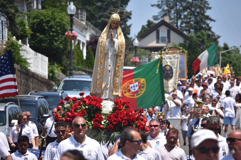 The Our Lady of Good Voyage statue is carried down Main Street during Sunday's Fiesta procession, July 1, 2018. (Greg Cook)
