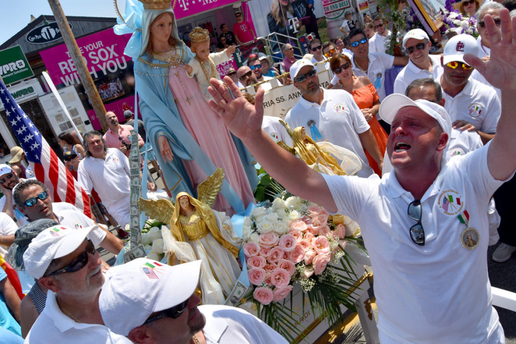 Gus MacIntosh shouts blessings for the Mother of Grace during Sunday's Fiesta procession, July 1, 2018. (Greg Cook)