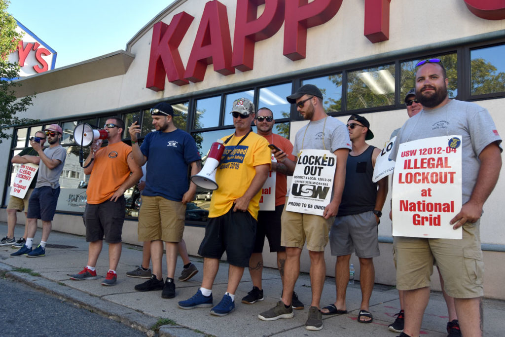 Gas workers, locked-out by National Grid in a contract dispute, protested at a company work site on Main Street in Malden, July 19, 2018. (Greg Cook)