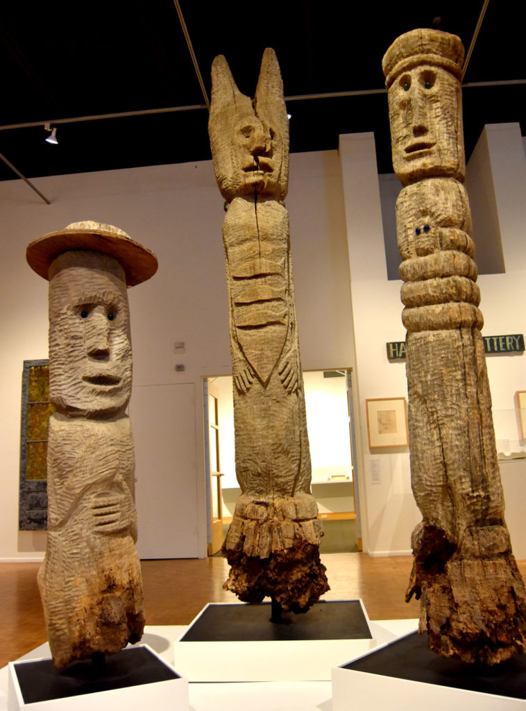 "Wooden totems by Mary Nohl in the exhibit ""Mary Nohl and the Walrus Club"" at the Kohler Arts Center in Sheboygan, Wisconsin, July 9, 2018. (Greg Cook)"