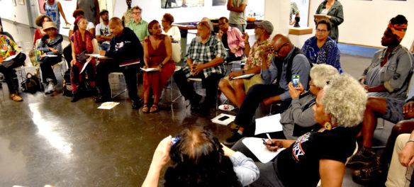 African American Master Artists In Residence Program artists and supporters meet in the fourth-floor gallery at the studios at 76 Atherton St., Boston, Aug. 12, 2018. (Greg Cook)