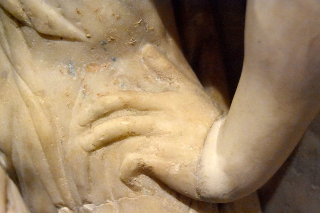 Bits of color remain on the gown of one figure on the Gardner Museum's Farnese Sarcophagus. (Greg Cook)