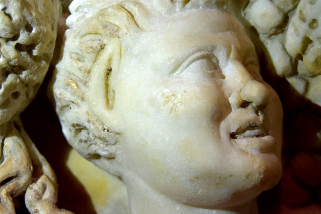 A bit of gold remains visible in the hair of one figure on the Gardner Museum's Farnese Sarcophagus. (Greg Cook)