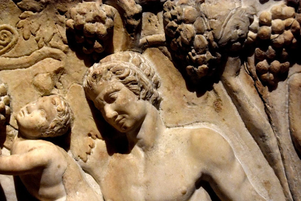 Carlo Albacini's recarving of the Farnese Sarcophagus is visible in chisel lines around the shoulder of one male figure on the right side, where the sculptor worked into the original marble. (Greg Cook)