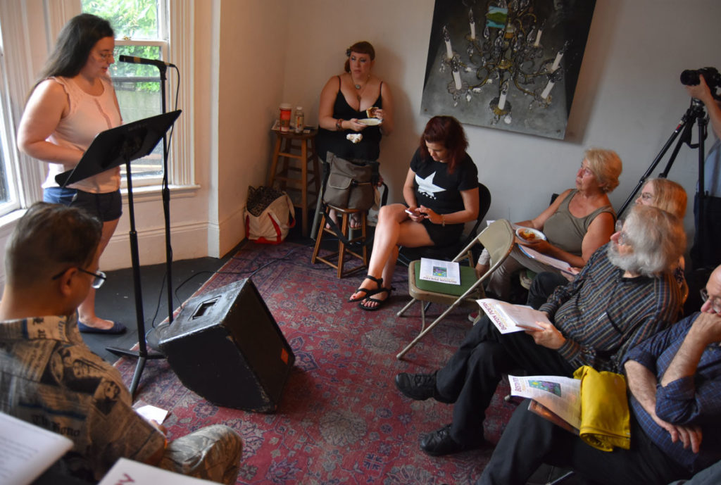 Catherine LeBeau reads at the 2018 Boston Poetry Marathon at Outpost 186, Cambridge, Aug. 12, 2018. (Greg Cook)