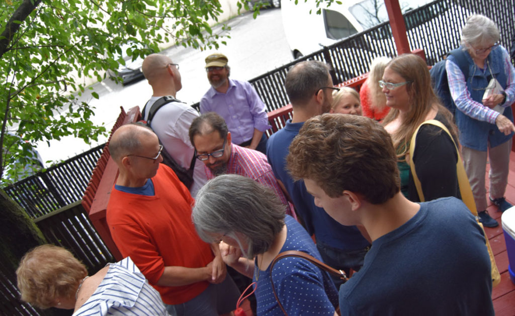 The crowd chats between readings at the 2018 Boston Poetry Marathon at Outpost 186, Cambridge, Aug. 12, 2018. (Greg Cook)