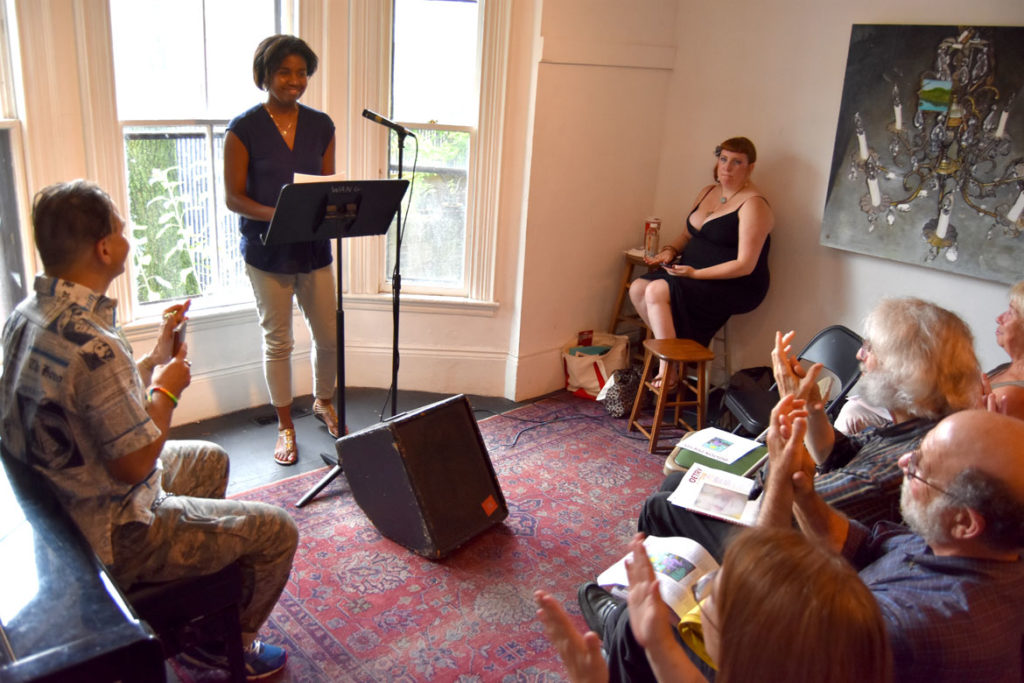 January O'Neil reads at the 2018 Boston Poetry Marathon at Outpost 186, Cambridge, Aug. 12, 2018. (Greg Cook)