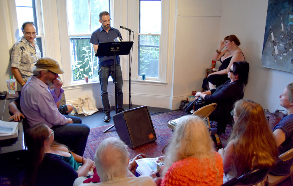 Sean Cole reads at the 2018 Boston Poetry Marathon at Outpost 186, Cambridge, Aug. 12, 2018. (Greg Cook)