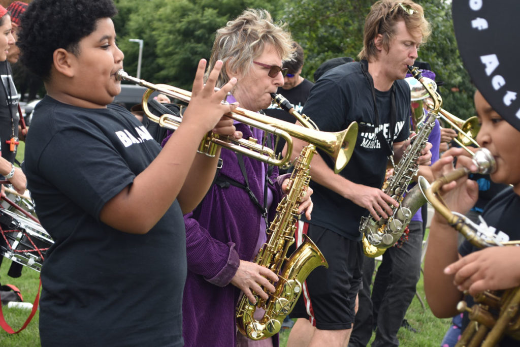 Babam (Boston Area Brigade of Activist Musicians) performs at the Boston Rise for Climate, Jobs, Immigrant Rights & Justice rally at East Boston Memorial Park, Sept. 8, 2018. (Greg Cook)