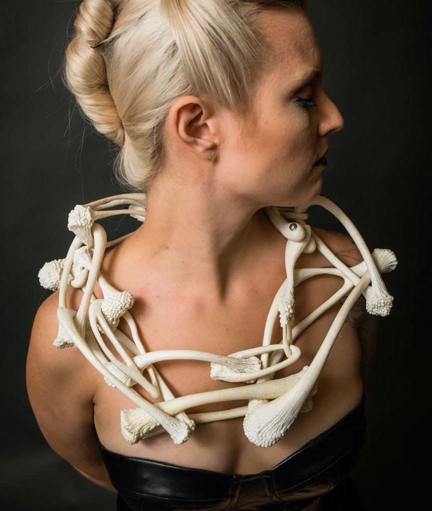"Caitlin Skelcey, ""Ubiquitous Bone Chain,"" 2016, ABS plastic, stainless steel machine screws, 3D printing pen, implanted screws. (Courtesy Fuller Craft Museum)"