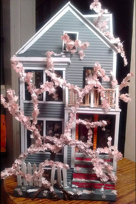 Dina Gjertsen's model of a condo overwhelmed by a cherry tree.