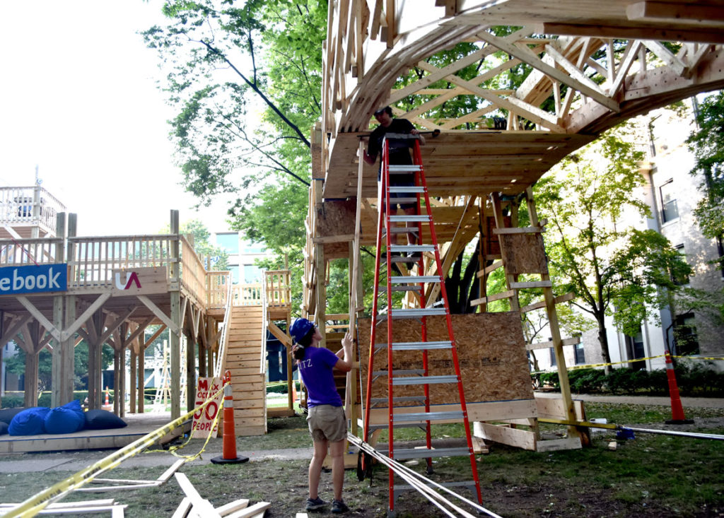 Constructing the temporary bridge spanning the courtyard of Massachusetts Institute of Technology's East Campus residence hall, Cambridge, Aug. 28, 2018. (Greg Cook)