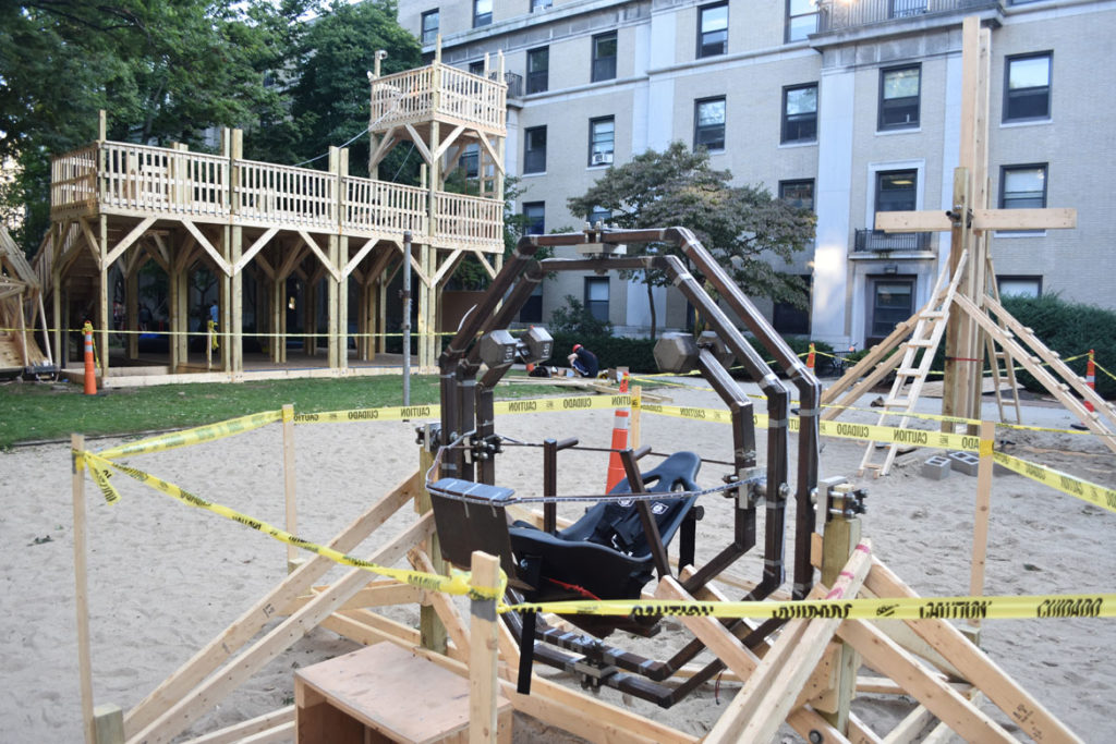 The space trainer, trebuchet and fort in the courtyard of Massachusetts Institute of Technology's East Campus residence hall, Cambridge, Aug. 28, 2018. (Greg Cook)