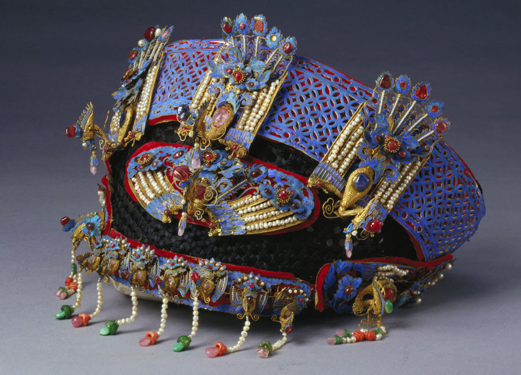 Festive headdress with phoenixes and peonies, probably imperial workshop, Beijing, Tongzhi or Guangxi period, probably 1872 or 1888-89, silver with gilding, kingfisher feathers, pearls, coral, jadeite, ruby, sapphire, tourmaline, turquoise, lapis lazuli, glass, metal wire, silk satin, velvet, cardboard. (Courtesy Peabody Essex Museum)