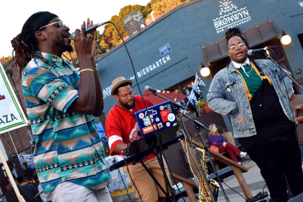 Cliff Notez (from left), Tim Hall and Oompa perform at Somerville's Evolution of Hip Hop Festival in Union Square, Sept. 29, 2018. (Greg Cook)