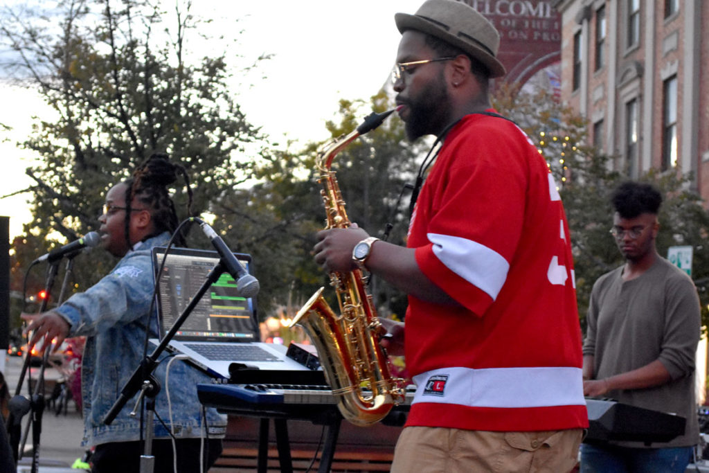 Tim Hall joins Oompa on sax at Somerville's Evolution of Hip Hop Festival in Union Square, Sept. 29, 2018. (Greg Cook)
