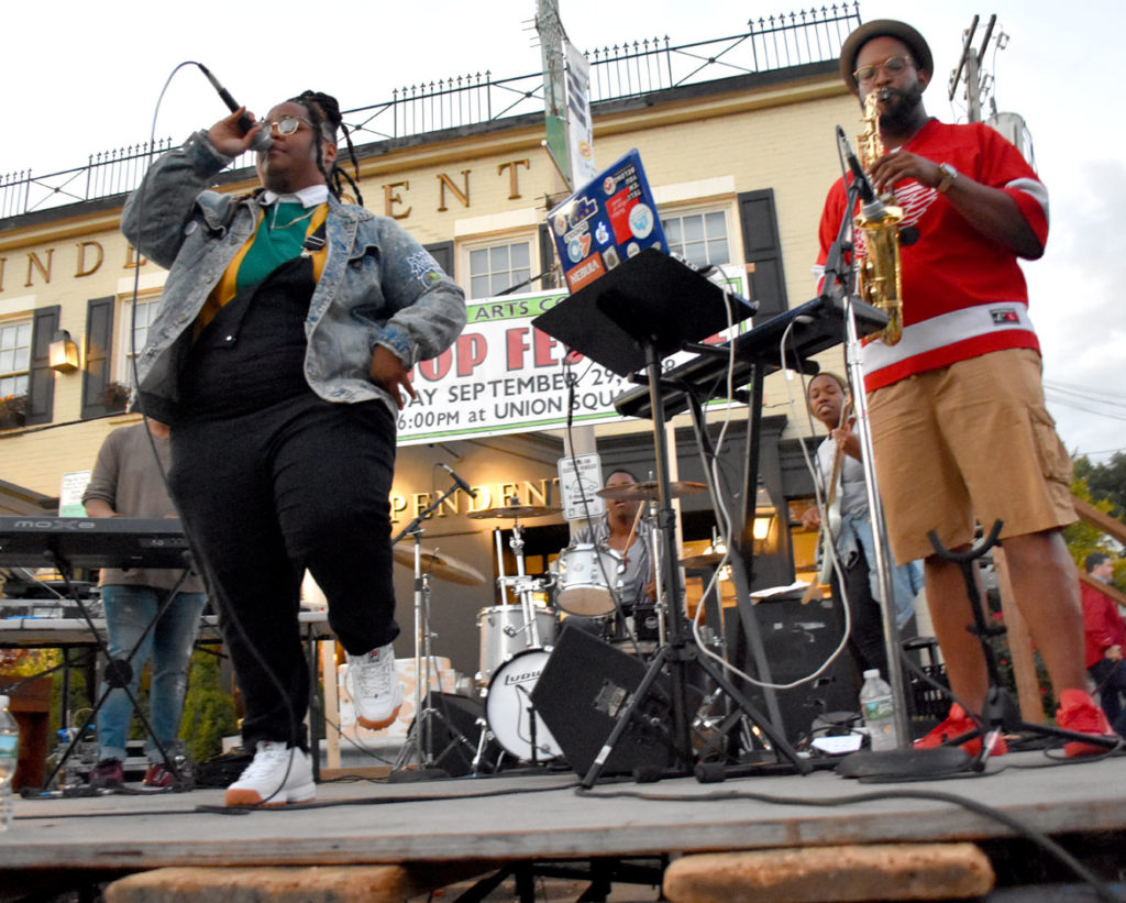 Oompa (left) performs with Tim Hall at Somerville's Evolution of Hip Hop Festival in Union Square, Sept. 29, 2018. (Greg Cook)