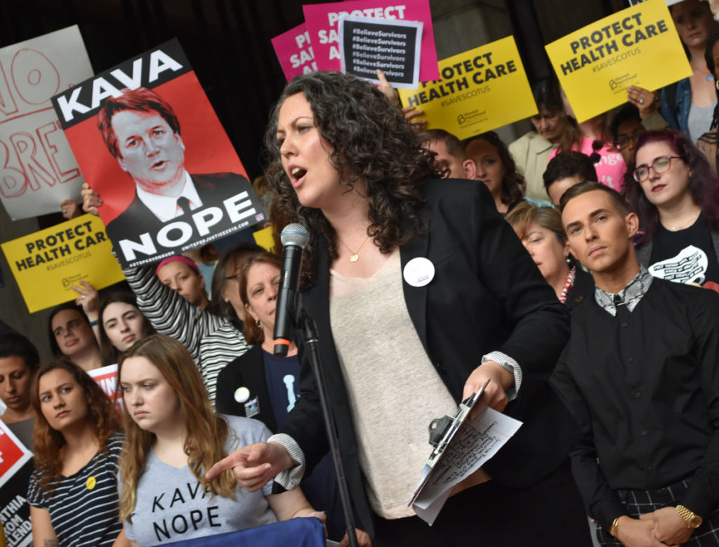 "Rebecca Hart Holder, executive director of NARAL Pro-Choice Massachusetts, said at the ""Tell Jeff Flake to Reject Kavanaugh"" rally on the steps of Boston City Hall, Oct. 1, 2018. (Greg Cook)"