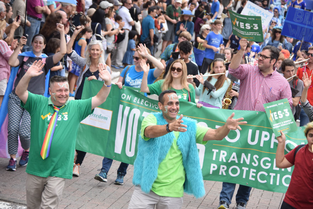 Cambridge Mayor Marc McGovern (left) and Somerville Mayor Joe Curtatone march with the Vote Yes On [Ballot Question] 3 group, to uphold protections for transgender people in Massachusetts, in the Honk Parade, Oct. 7, 2018. (Greg Cook)