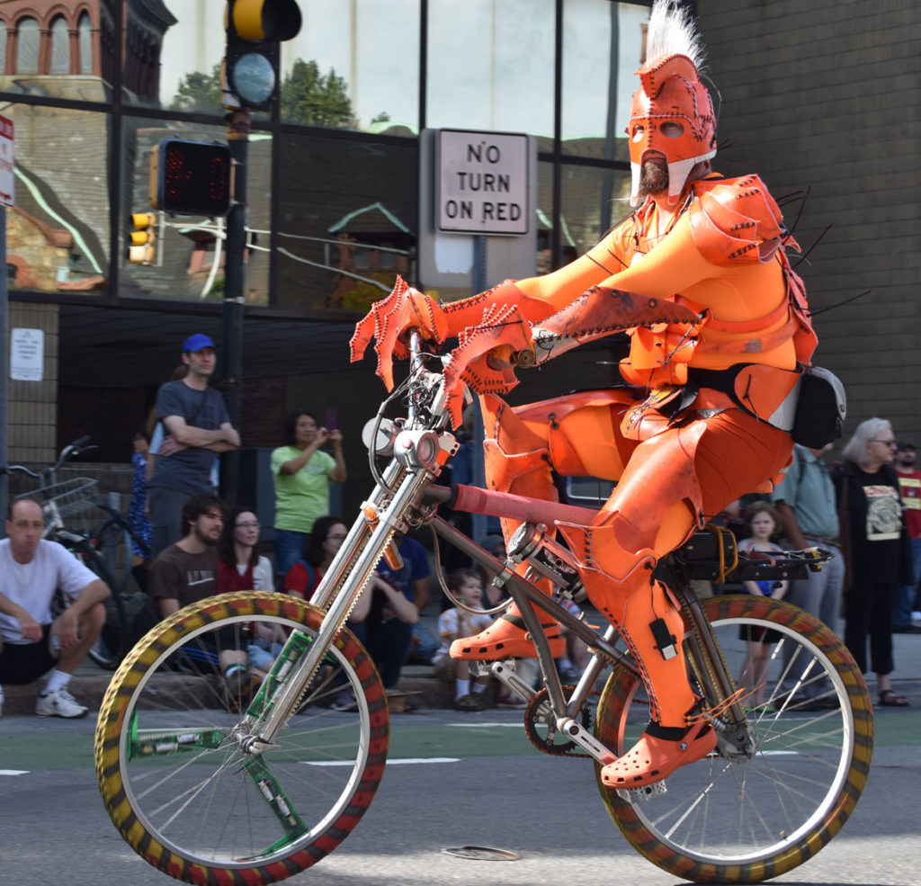 SCUL bicycler from Somerville in the Honk Parade, Oct. 7, 2018. (Greg Cook)