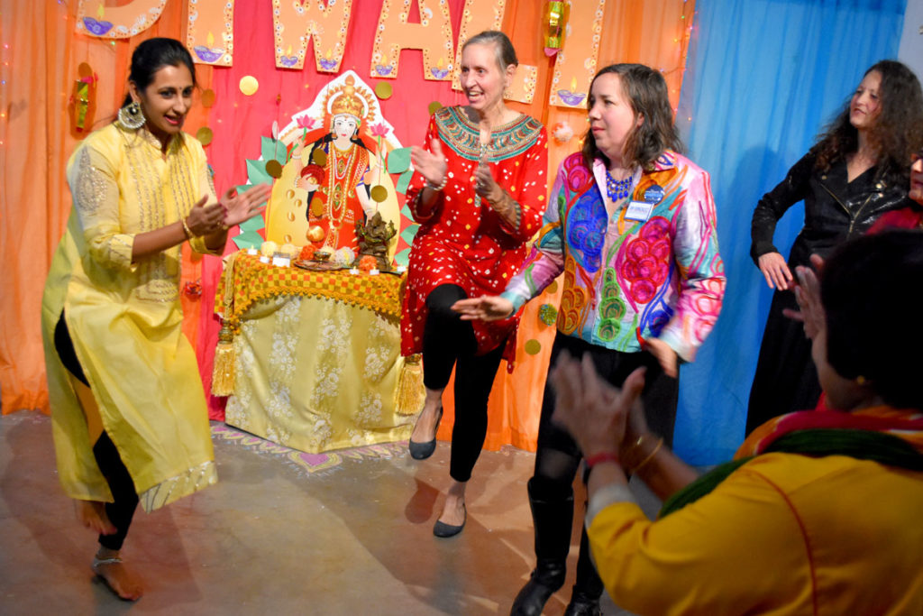 Amrutha Ananth leads the audience in Bollywood dancing during the Dawali celebration at the Gallery, Malden, Nov. 1, 2018. (Greg Cook)