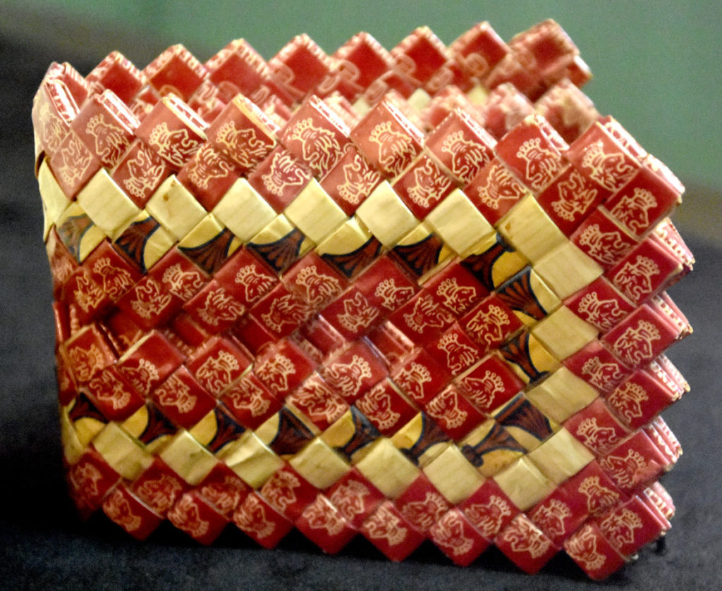 """Wallet made at Attica Correctional Facility, New York, in the 1970s in """"Inmate Ingenuity"""" at the Museum of the National Center of Afro-American Artists. (Greg Cook)"""
