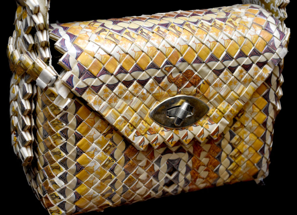 """Purse made at Rikers Island, New York, in the 1950s in """"Inmate Ingenuity"""" at the Museum of the National Center of Afro-American Artists. (Greg Cook)"""