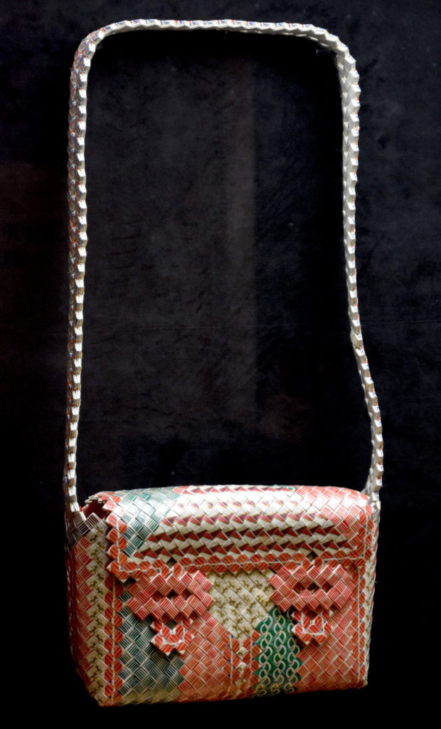 """Purse made by Shawn Powell at San Quentin State Prison, California, 1941, in """"Inmate Ingenuity"""" at the Museum of the National Center of Afro-American Artists. (Greg Cook)"""