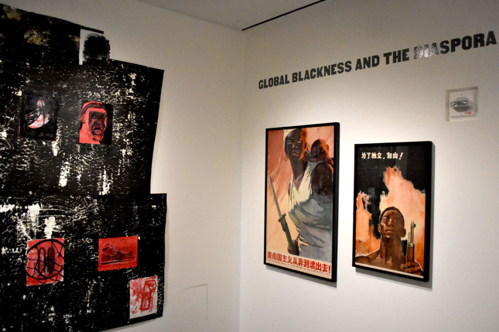 """Nine Moments from Now"" at Cooper Gallery. From left: Marlon Forrester, ""BlackSunsetComing,"" 2018; Wu Min, ""US Imperialism Get Out of Africa!,"" 1964; Zhan Jianjin, ""For Indepedence and Freedom,"" 1962."