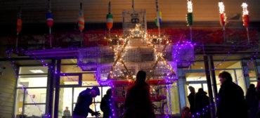 Lighting the Lobsta Trap Menorah for the third night of Hanukkah at Temple Ahavat Achim, Gloucester, Dec. 4, 2018. (Greg Cook)