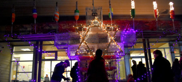 Lighting the Lobsta Trap Menorah for the third night of Hanukkah at Temple Ahavat Achim, Gloucester, Dec. 4, 2018. (Greg Cook)