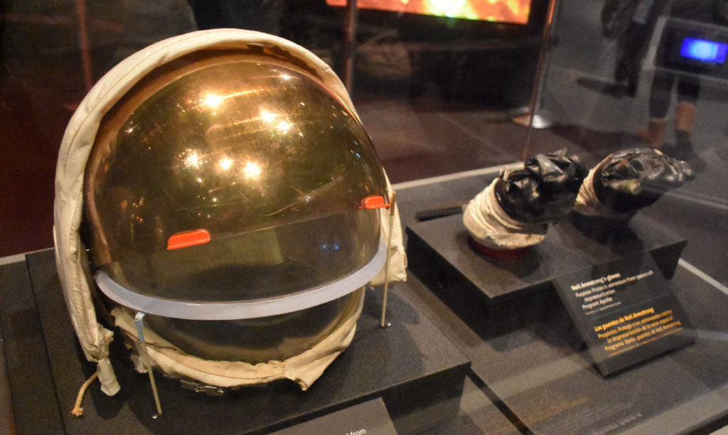 "Note: These are not the space globes you get to try on. These are actually an Apollo program helmet and Neal Armstrong's gloves at ""Space: An Out-of-Gravity Experience"" at Boston's Museum of Science. (Greg Cook)"