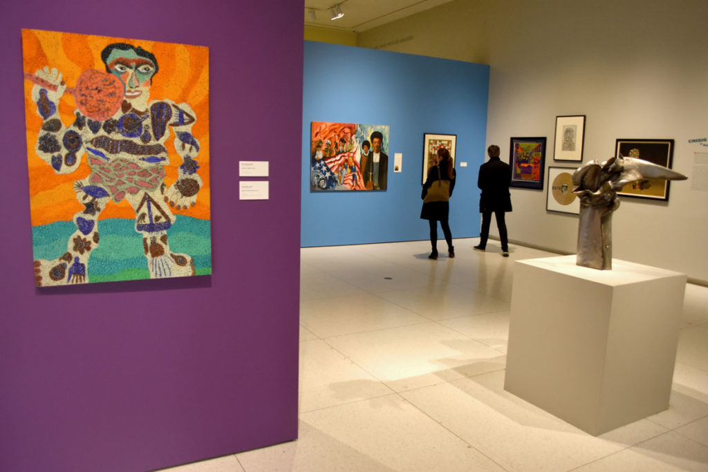 "Pauline Simon's painting ""Tattooed Weight Lifter,"" 1973 (left), and Richard Hunt's welded steel sculpture ""Winged Hybrid Figure No. 3,"" 1965 (right), in ""The Time is Now! Art Worlds of Chicago's South Side, 1960–1980"" at the Smart Museum of Art, The University of Chicago. (Greg Cook)"