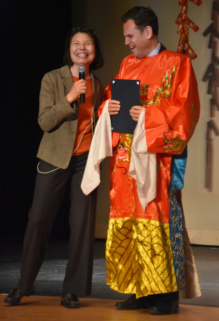 Chinese Culture Connection Executive Director Mei Hung (left) and Malden Mayor Gary Christensen during Chinese Lunar New Year Celebration at Malden High School, Jan. 26, 2019. (Greg Cook)