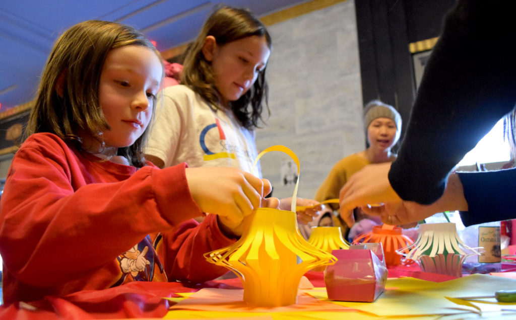 Making paper lanterns during Chinese Lunar New Year Celebration at Malden High School, Jan. 26, 2019. (Greg Cook)