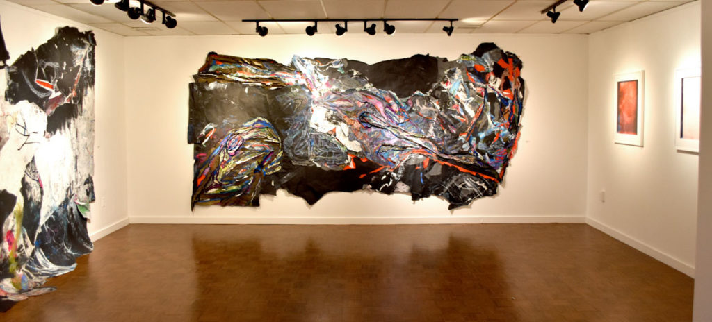 """Dell Hamilton's exhibition """"All Languages Welcomed Here"""" at Salem State University, Jan. 9, 2019. Center: """"Leviathan, The Blue Knight (aka The Beast),"""" 2017-2018."""