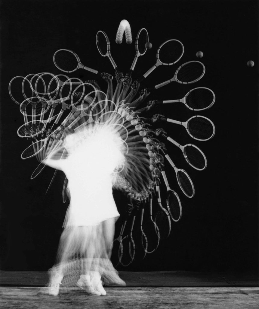 "Harold Edgerton, ""Gussie Moran Tennis Serve, Multiflash,"" 1949. ""Edgerton brought his strobes and other equipment to Longwood to photograph the touring tennis stars. He was given a few minutes with each in an anteroom before they went out for their matches. The outstanding tennis player, Moran tosses the ball into a perfect parabola for a power serve. This unique vintage print was the actual print used to reproduce the plate in 'Flash!,' published in 1954."""