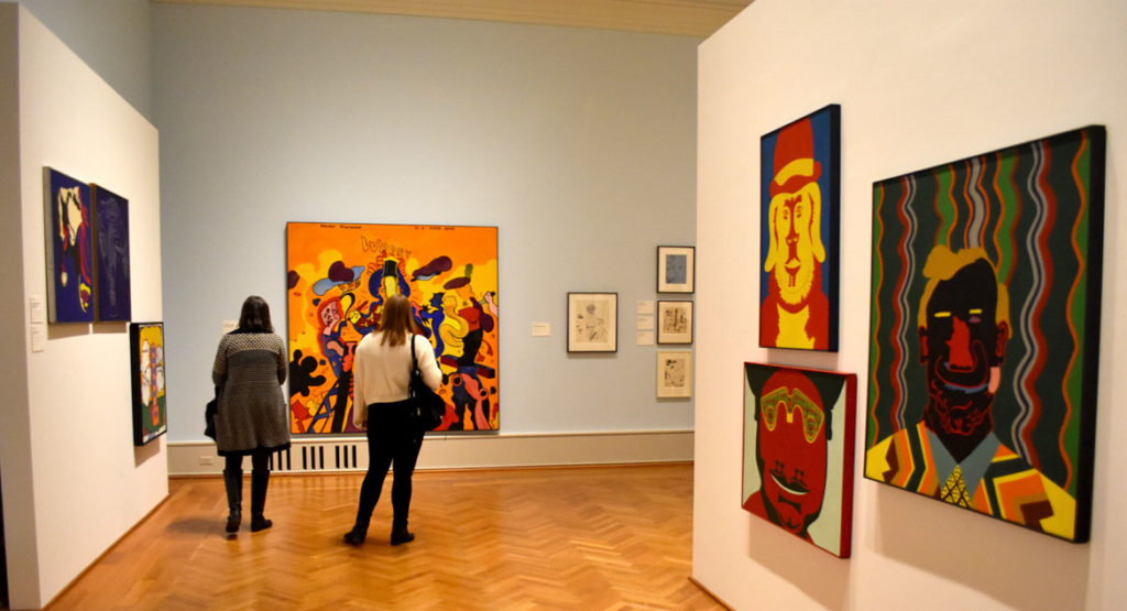 "Jim Falconer's 1966 painting ""Morbid Sunshine by a Miner Artist"" (center) and paintings by Karl Wirsum in ""Hairy Who? 1966–1969"" at the Art Institute of Chicago. (Greg Cook)"