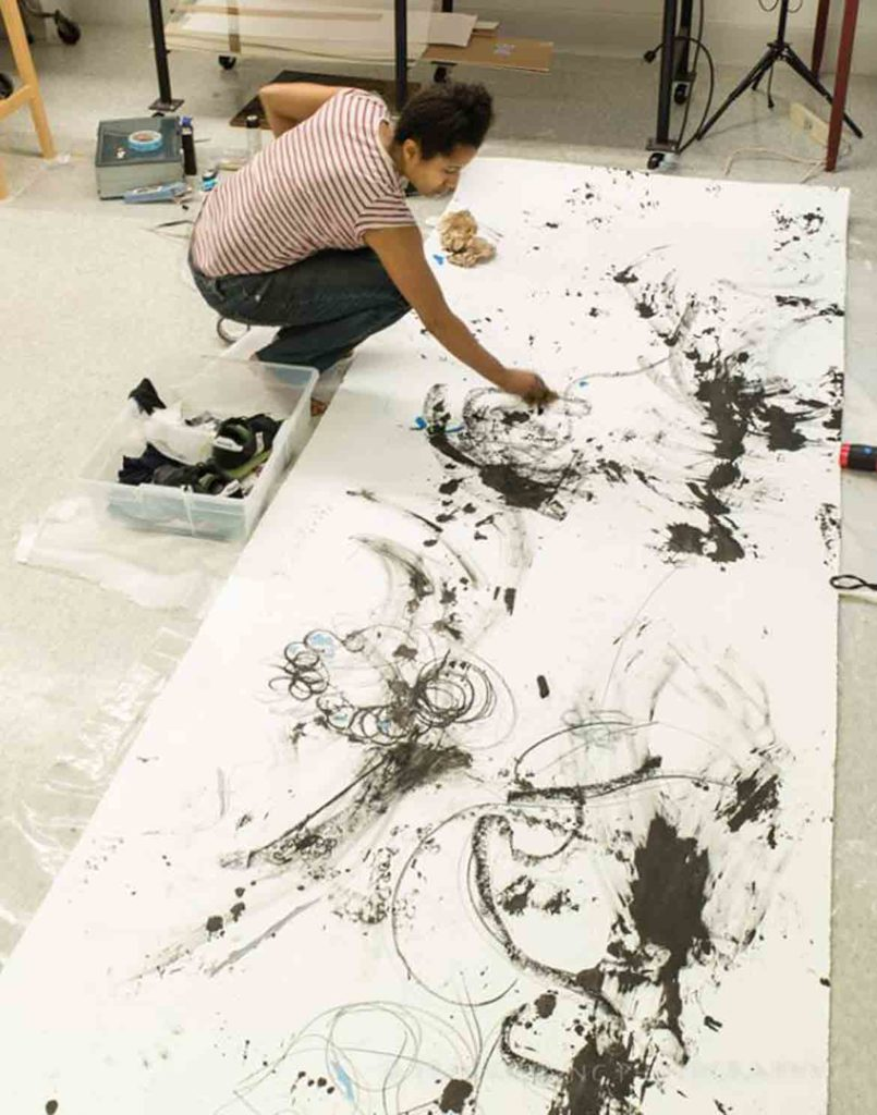 """Dell Hamilton begins work on """"How Does It Feel to Put Yourself Back Together After You've Been Torn Apart?"""" in November 2017 at the Menino Art Center in Hyde Park, Boston. (Photo: Erik Gehring)"""