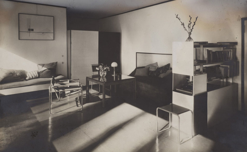 "Lucia Moholy, ""Bauhaus Masters Housing, Dessau, 1925–26: Lucia Moholy and László Moholy-Nagy's Living Room,"" c. 1925, gelatin silver print with gouache retouchings. (© Lucia Moholy Estate/Artists Rights Society (ARS), New York/VG Bild-Kunst, Bonn. © President and Fellows of Harvard College)"