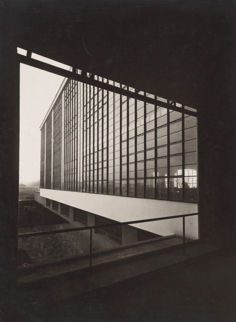 "At Harvard Art Museums: Lucia Moholy (photograph) and Walter Gropius (architecture), ""Bauhaus Building, Dessau,"" 1926. Gelatin silver print. (Harvard Art Museums/Busch-Reisinger Museum)"