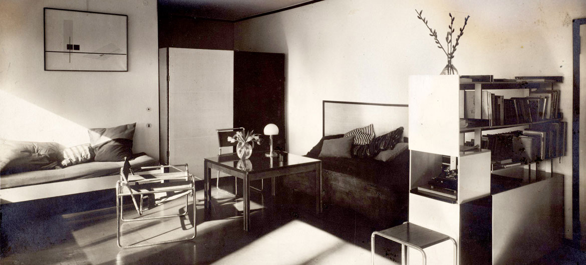 "At Harvard Art Museums: Lucia Moholy, ""Bauhaus Masters Housing, Dessau (Lucia Moholy and László Moholy-Nagy's living room),"" 1927–28. Gelatin silver print with opaque watercolor retouching. (Harvard Art Museums/Busch-Reisinger Museum)"
