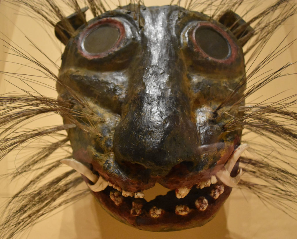 Jaguar mask made in Guerrero, late 19th century, glass, painted wood, animal teeth, boar bristle. (Greg Cook photo)