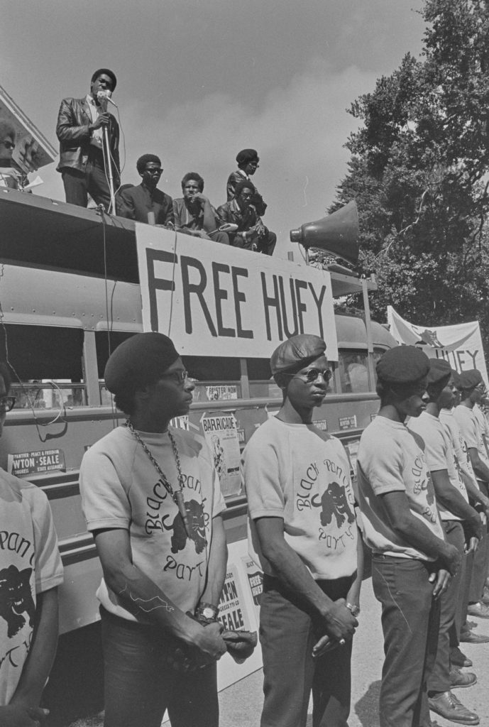 "Pirkle Jones, ""Bobby Seale speaking on Free Huey Rally Bus, Free Huey Rally, De Fremery Park, Oakland, CA,"" July 14, 1968. (Courtesy University of California, Santa Cruz)"