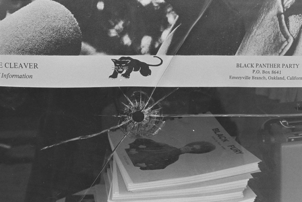 "Pirkle Jones, ""Black Panther Party national Headquarters window, shattered by the bullets of two Oakland, California policemen,"" Sept. 10, 1968. (Courtesy University of California, Santa Cruz)"