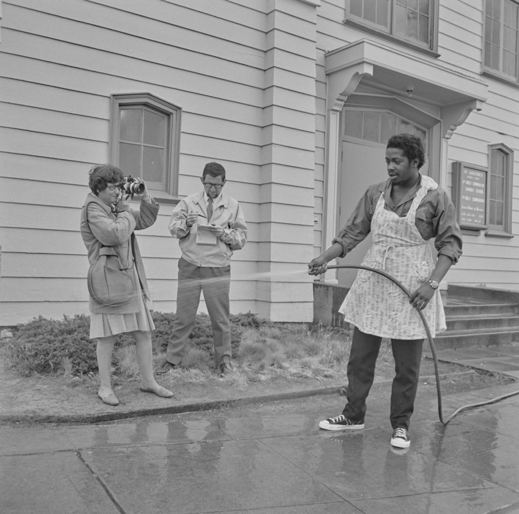 "PirkleJones, ""Ruth-Marion Baruch photographing Charles Bursey at the Black Panther Free Breakfast for Children Program, St. Augustine's Episcopal Church,"" May 19, 1969. (Courtesy University of California, Santa Cruz)"
