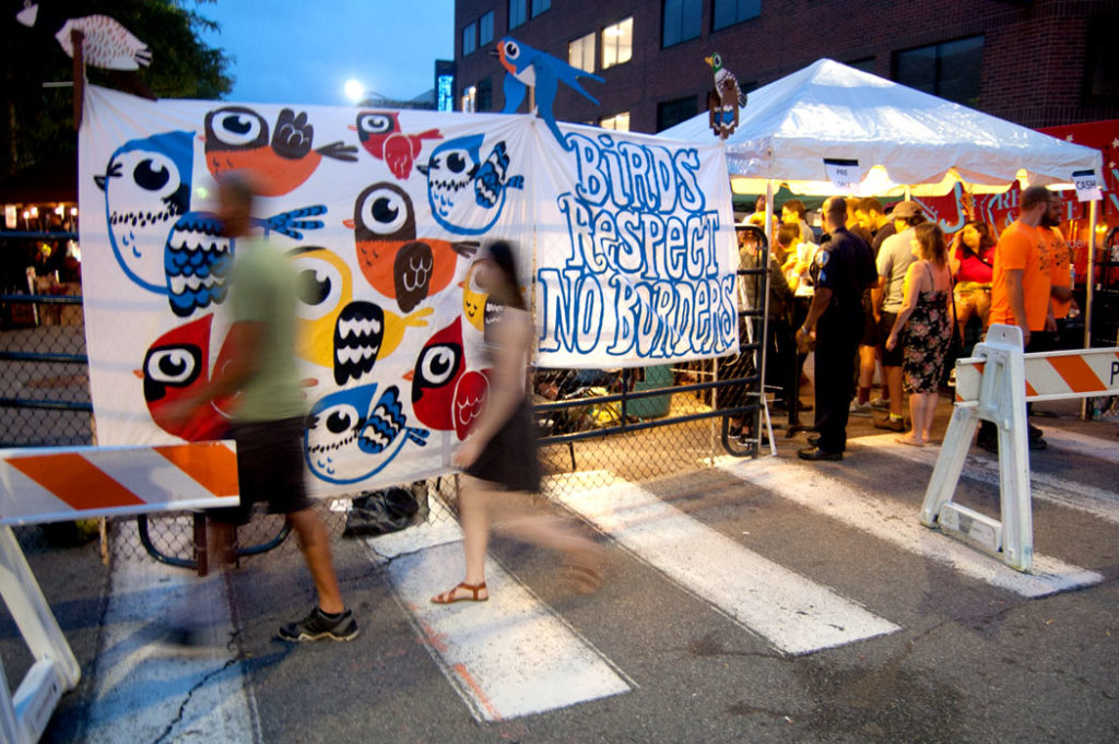 "Greg Cook's ""Birds Respect No Borders"" banners at AS220 Foo Fest, Providence, Aug. 12, 2017. (Greg Cook)"