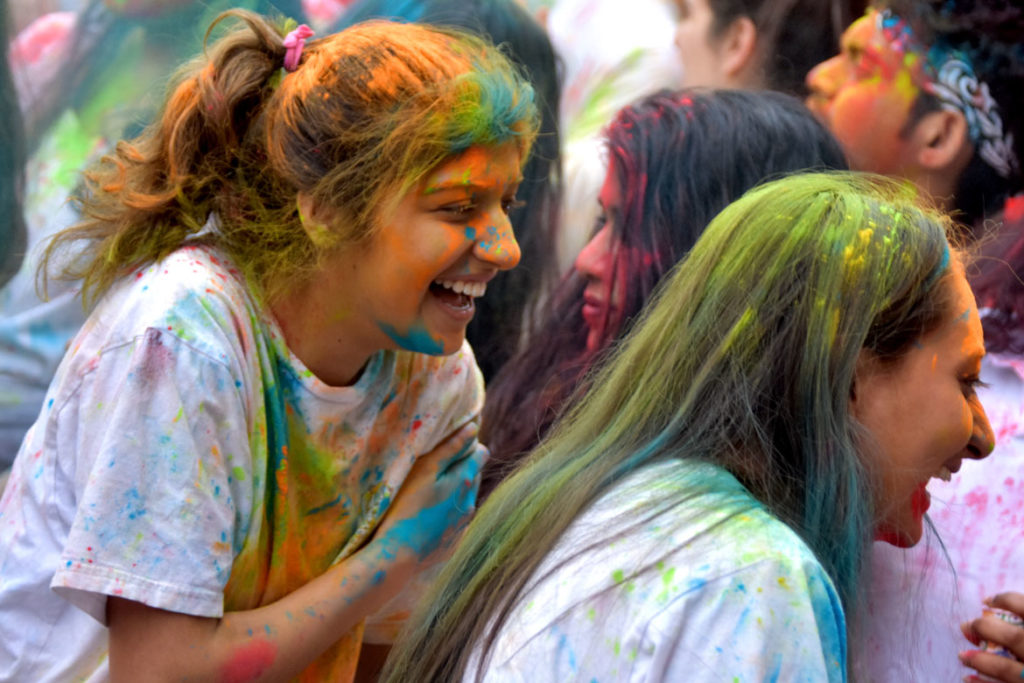 Celebrating Holi in an event organized by the Boston University Hindu Student Council, March 30, 2019. (Greg Cook)